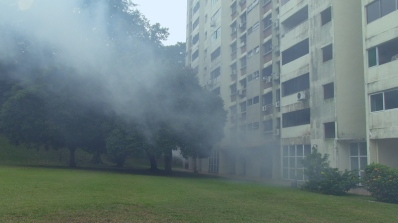 IN_TIME_TO_COME_3_Caption_routine_mosquito_fogging_casts_housing_estate_in_fog-Still020