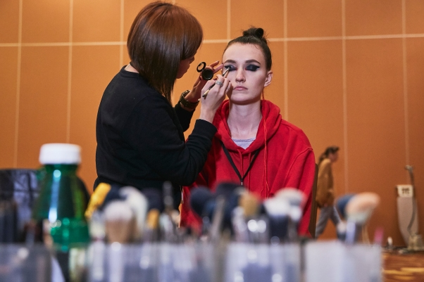 A model getting her final touches before taking the stage at the WTA Finals Gala Dinner