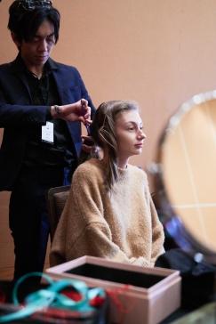 Behind the scenes as models prepare to walk the purple carpet