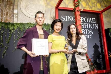 Senior Minister Sim Ann with Chelsea Scott-Blackhall
